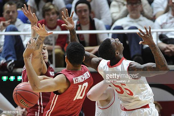 Jordan Railey and Dexter KernichDrew of the Washington State Cougars along with Delon Wright of the Utah Utes miss the rebound during second half...