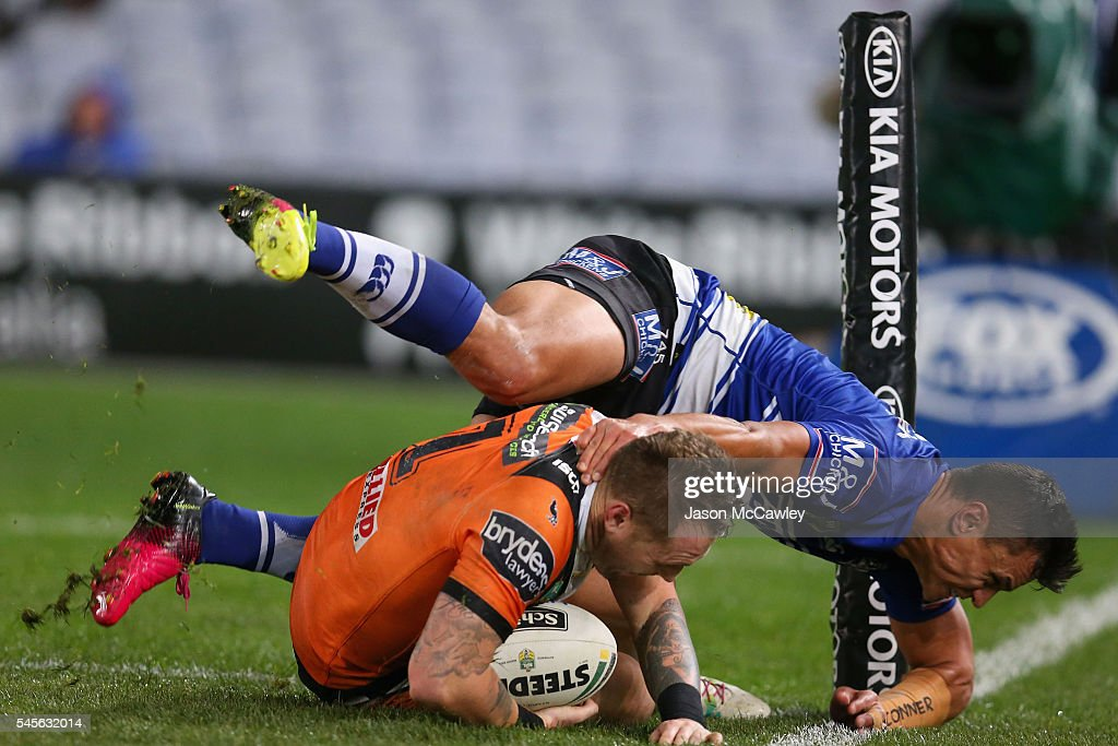 Jordan Rankin of the Tigers is tackled into touch by Sam Perrett of the Bulldogs during the round 18 NRL match between the Canterbury Bulldogs and the Wests Tigers at ANZ Stadium on July 9, 2016 in Sydney, Australia.