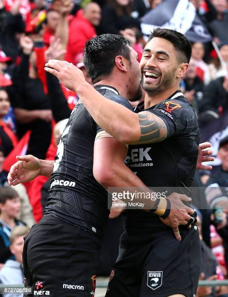 Jordan Rapana and Shaun Johnson of the Kiwis celebrate during the 2017 Rugby League World Cup match between the New Zealand Kiwis and Tonga at...