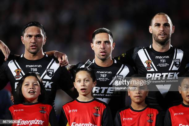 Jordan Rapana Gerard Beale and Simon Mannering of the Kiwis sing the national athem ahead of the 2017 Rugby League World Cup match between the New...