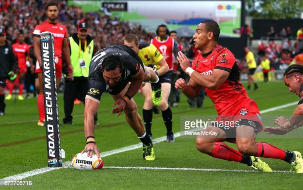 Jordan Rapana of the Kiwis scores a try during the 2017 Rugby League World Cup match between the New Zealand Kiwis and Tonga at Waikato Stadium on...