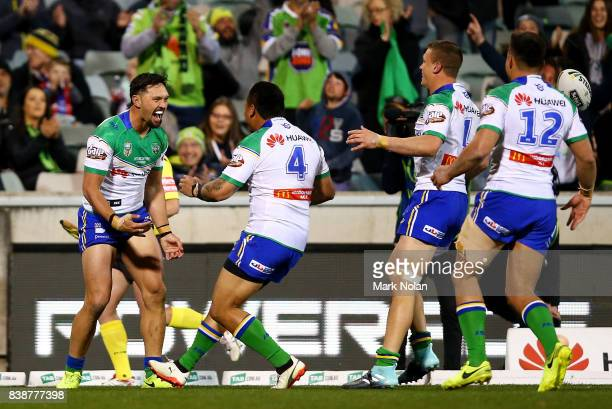 Jordan Rapana of the Raiders celebrates a try with team mates during the round 25 NRL match between the Canberra Raiders and the Newcastle Knights at...