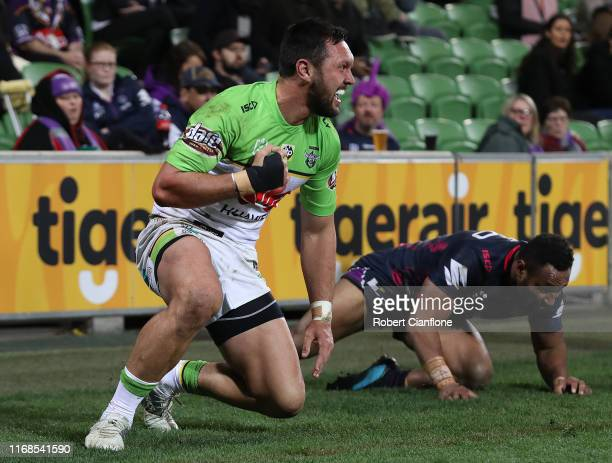 Jordan Rapana of the Raiders celebrates after scoring a try during the round 22 NRL match between the Melbourne Storm and the Canberra Raiders at...
