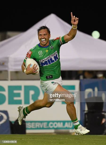 Jordan Rapana of the Raiders celebrates as he scores the game winning try during the round 24 NRL match between the New Zealand Warriors and the...
