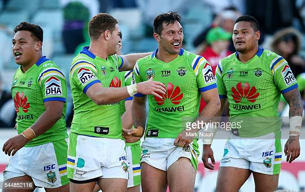Jordan Rapana of the Raiders is congratulated after scoring a golden point try during the round 17 NRL match between the Canberra Raiders and the...