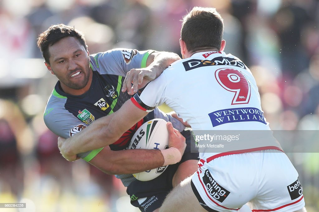 Jordan Rapana of the Raiders is tackled by Cameron McInnes of the Dragons during the round 11 NRL match between the St George Illawarra Dragons and the Canberra Raiders at Glen Willow Sporting Complex on May 20, 2018 in Mudgee, Australia.