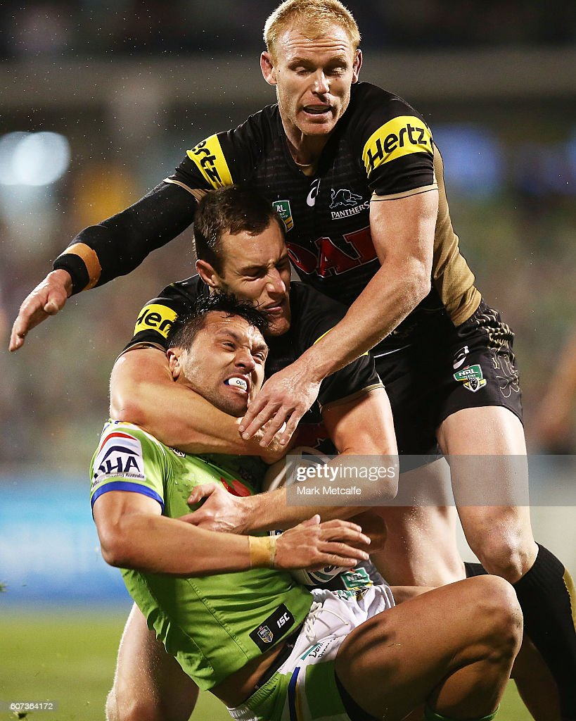 Jordan Rapana of the Raiders is tackled by Isaah Yeo and Peter Wallace of the Panthers during the second NRL Semi Final match between the Canberra Raiders and the Penrith Panthers at GIO Stadium on September 17, 2016 in Canberra, Australia.