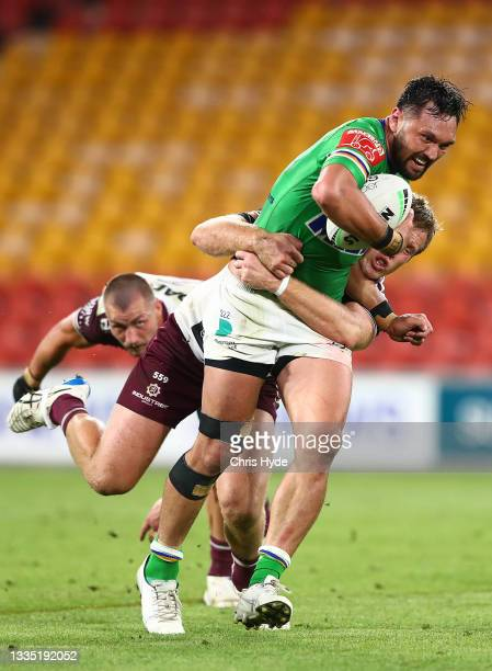 Jordan Rapana of the Raiders is tackled by Jake Trbojevic of the Sea Eagles during the round 23 NRL match between the Canberra Raiders and the Manly...