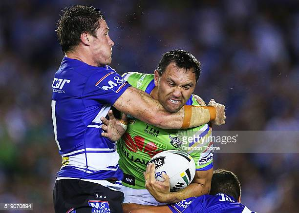 Jordan Rapana of the Raiders is tackled by Josh Jackson of the Bulldogs during the round five NRL match between the Canterbury Bulldogs and the...