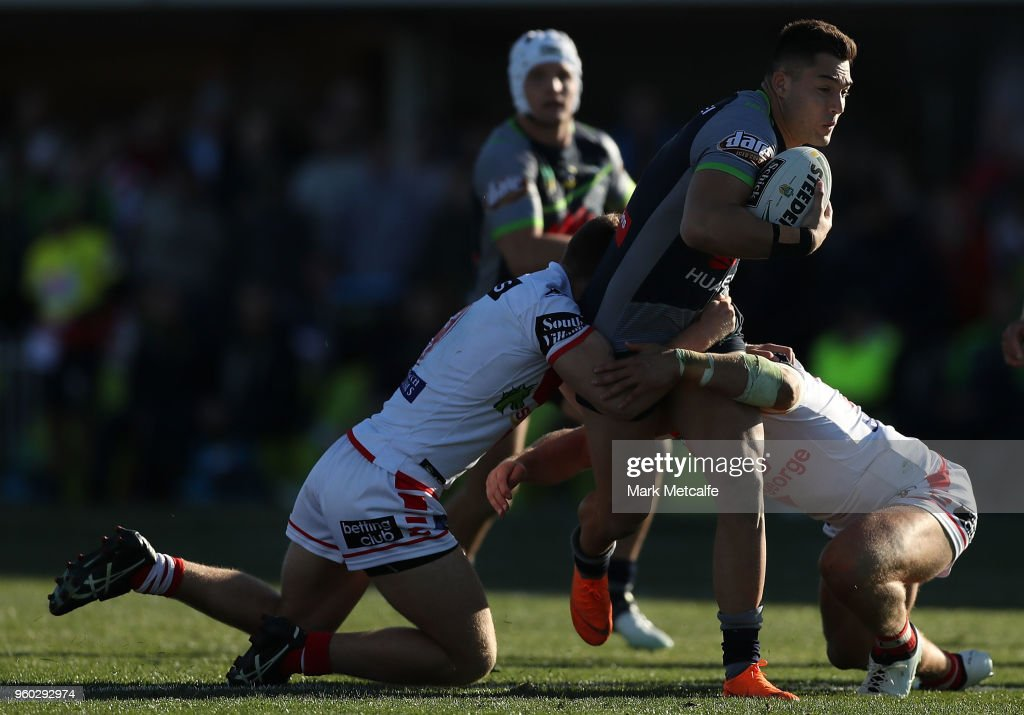 Jordan Rapana of the Raiders is tackled during the round 11 NRL match between the St George Illawarra Dragons and the Canberra Raiders at Glen Willow Sporting Complex on May 20, 2018 in Mudgee, Australia.