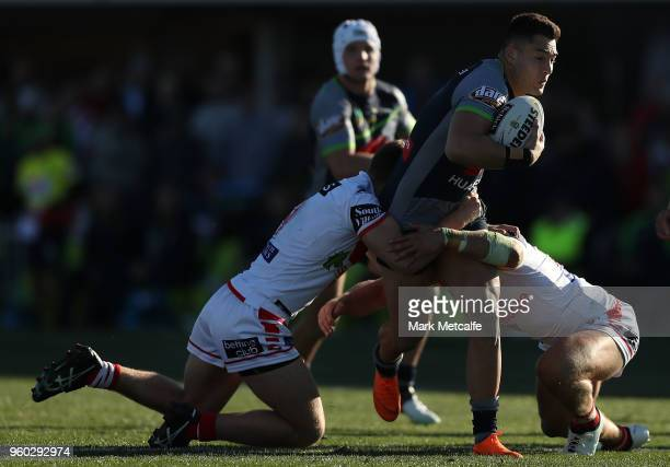 Jordan Rapana of the Raiders is tackled during the round 11 NRL match between the St George Illawarra Dragons and the Canberra Raiders at Glen Willow...