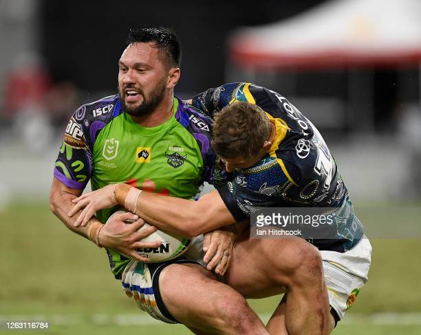 Jordan Rapana of the Raiders is tackled during the round 12 NRL match between the North Queensland Cowboys and the Canberra Raiders at QCB Stadium on...