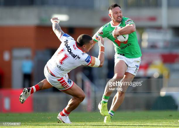 Jordan Rapana of the Raiders is tackled during the round 18 NRL match between the St George Illawarra Dragons and the Canberra Raiders at WIN Stadium...