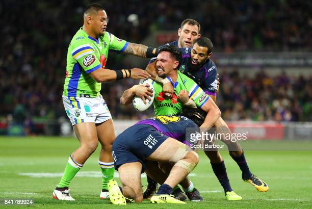 Jordan Rapana of the Raiders is tackled during the round 26 NRL match between the Melbourne Storm and the Canberra Raiders at AAMI Park on September...