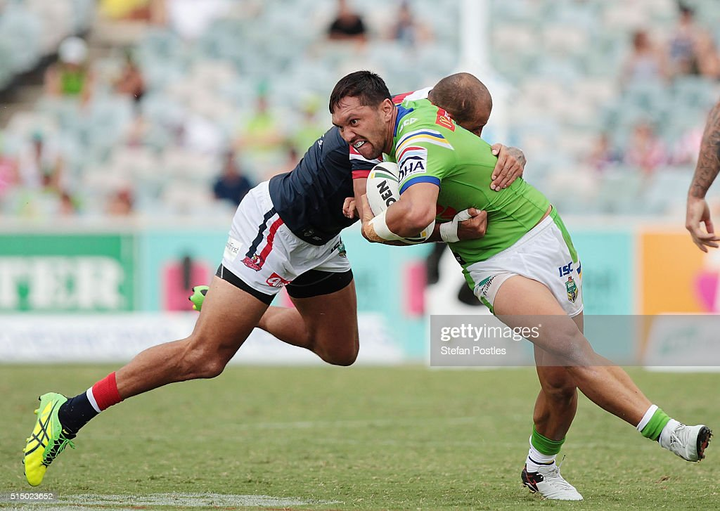 Jordan Rapana of the Raiders is tackled during the round two NRL match between the Canberra Raiders and the Sydney Roosters at GIO Stadium on March 12, 2016 in Canberra, Australia.
