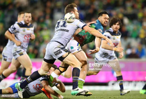 Jordan Rapana of the Raiders offloads during the round 17 NRL match between the Canberra Raiders and the North Queensland Cowboys at GIO Stadium on...