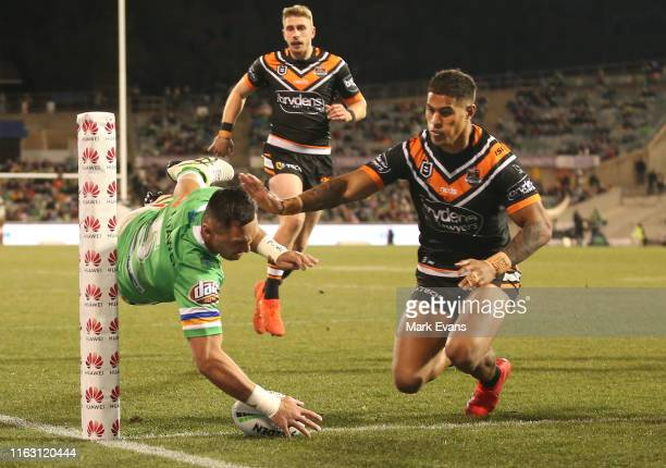 Jordan Rapana of the Raiders scores a try during the round 18 NRL match between the Canberra Raiders and the Wests Tigers at GIO Stadium on July 20,...