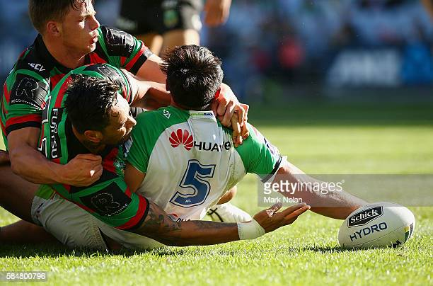 Jordan Rapana of the Raiders scores a try during the round 21 NRL match between the South Sydney Rabbitohs and the Canberra Raiders at ANZ Stadium on...