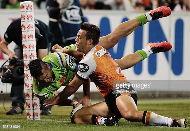 Jordan Rapana of the Raiders scores a try during the round eight NRL match between the Canberra Raiders and the Wests Tigers at GIO Stadium on April...
