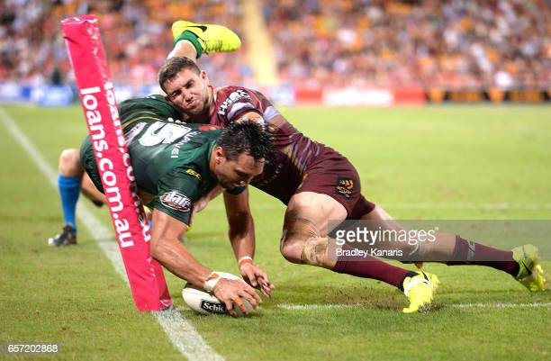 Jordan Rapana of the Raiders scores a try during the round four NRL match between the Brisbane Broncos and the Canberra Raiders at Suncorp Stadium on...