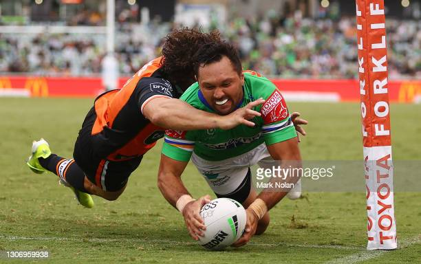 Jordan Rapana of the Raiders scores a try during the round one NRL match between the Canberra Raiders and the Wests Tigers at GIO Stadium, on March...