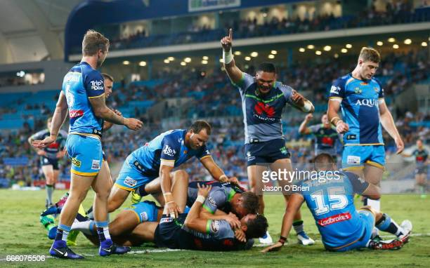 Jordan Rapana of the Raiders scores a try during the round six NRL match between the Gold Coast Titans and the Canberra Raiders at Cbus Super Stadium...