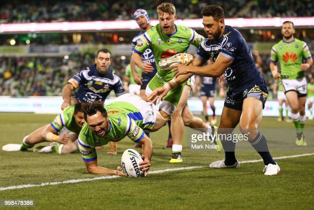 Jordan Rapana of the Raiders takes a high ball and scores a try during the round 18 NRL match between the Canberra Raiders and the North Queensland...