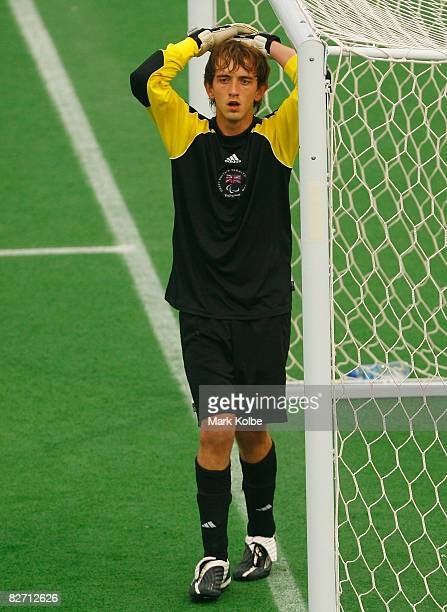 Jordan Raynes of Great Britain stands looking dejected in the goal mouth with his hands on his head after the Ukraine scored a goal in the...