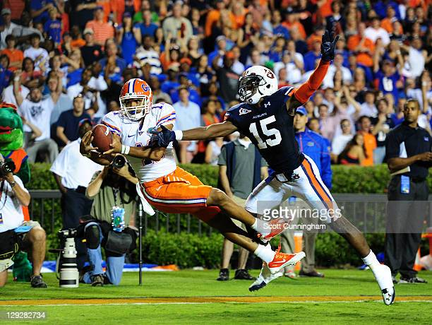 Jordan Reed of the Florida Gators is unable to hold on to a pass against Neiko Thorpe of the Auburn Tigers at JordanHare Stadium on October 15 2011...