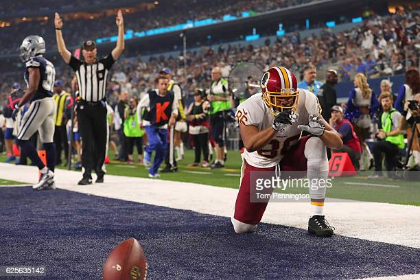 Jordan Reed of the Washington Redskins celebrates after catching a touchdown pass during the fourth quarter against the Dallas Cowboys at ATT Stadium...