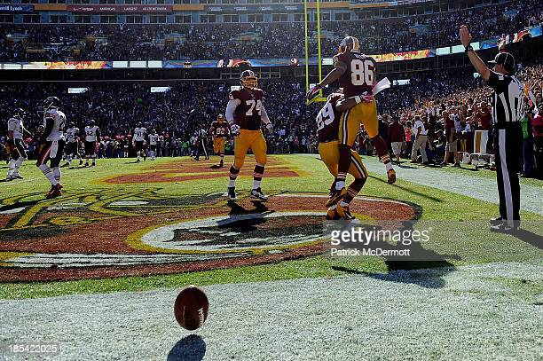 Jordan Reed of the Washington Redskins celebrates after scoring a touchdown in the second quarter during an NFL game against the Chicago Bears at...