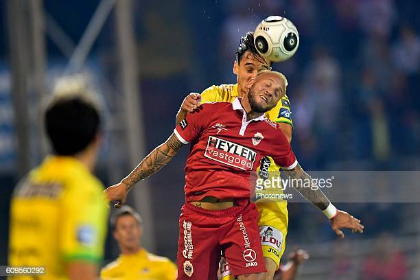 Jordan Remacle forward of Antwerp FC battles for the ball with Zarko Tomasevic defender of KV Oostende during the Croky Cup Round of 32 match between...