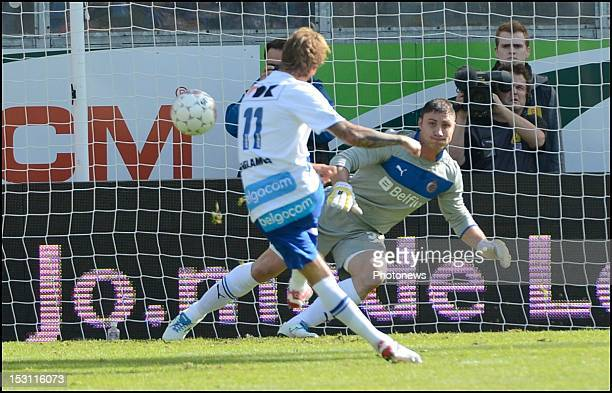 Jordan Remacle of Gent scores past Bojan Jorgacevic of Brugge during the Jupiler Pro league match between Kaa Gent and Fc Bruges on September 30 in...