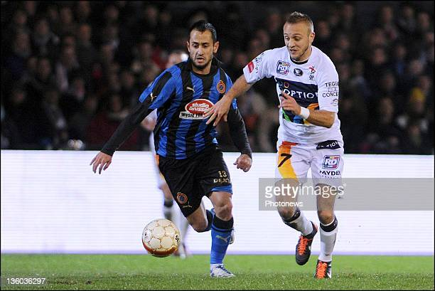 Jordan Remacle of OH Leuven challenges Victor Vazquez Solsona of Club Brugge during the Jupiler League match between OH Leuven and Club Brugge on...