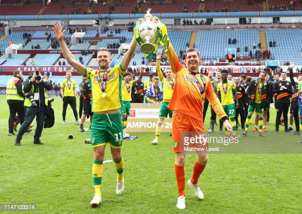 Jordan Rhodes and Michael McGovern of Norwich City lift the championship trophy in celebration after the Sky Bet Championship match between Aston...