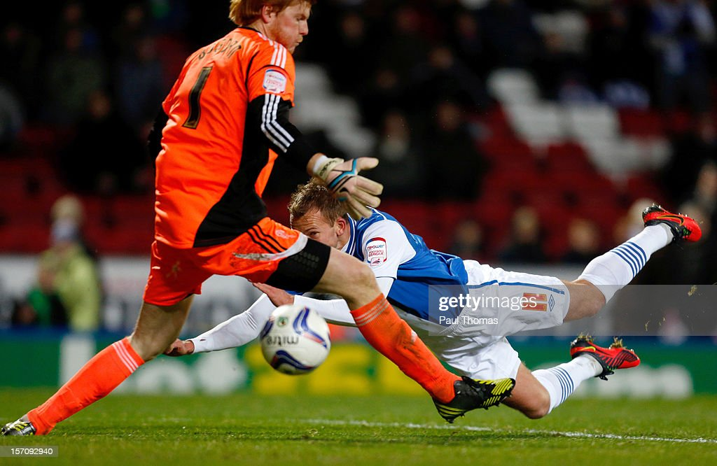 Jordan Rhodes (R) of Blackburn scores his sides first goal during the npower Championship match between Blackburn Rovers and Bolton Wanderers at Ewood Park on November 28, 2012 in Blackburn, England.