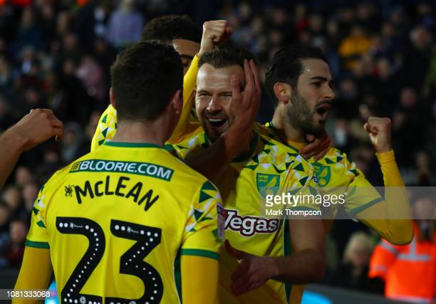 Jordan Rhodes of Norwich City celebrates with teammates after scoring his team's first goal during the Sky Bet Championship match between West...