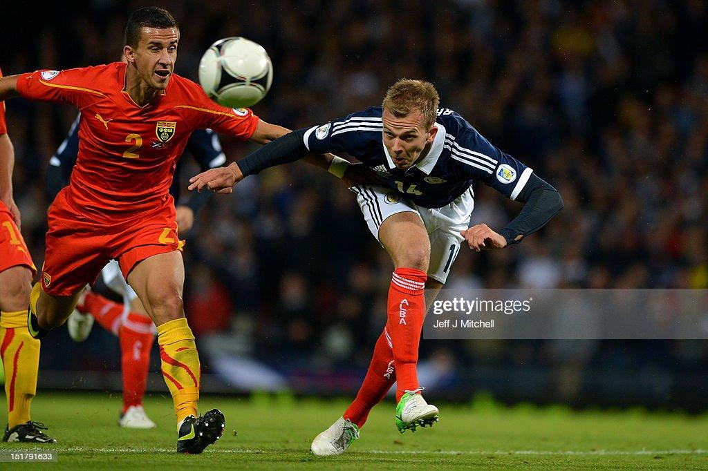 Jordan Rhodes of Scotland tackles Daniel Georgievski of Macedonia during the FIFA World Cup Qualifier Between Scotland and Macedonia at Hampden Park on September 11, 2012 in Glasgow, Scotland.