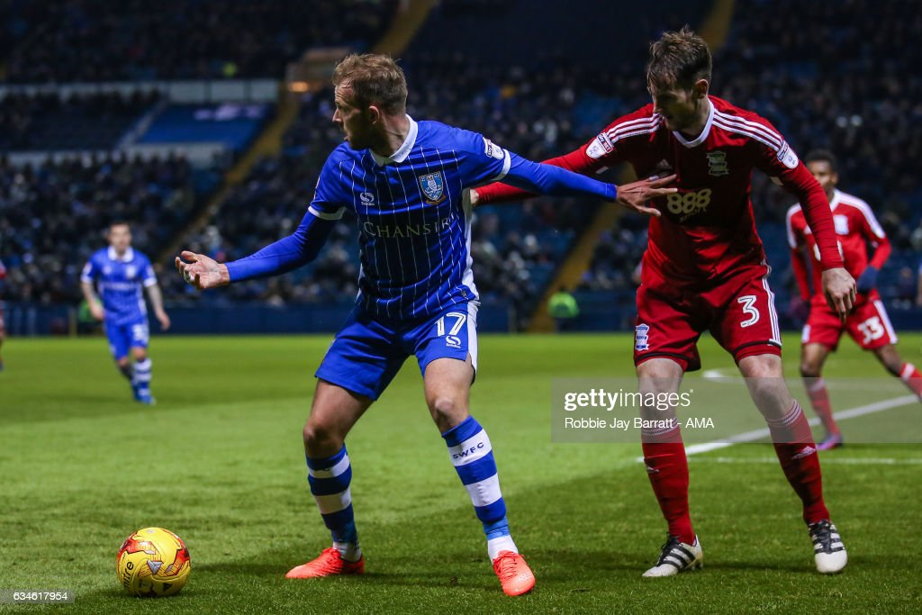 Jordan Rhodes of Sheffield Wednesday and Jonathan Grounds of Birmingham City during the Sky Bet Championship match between Sheffield Wednesday and Birmingham City at Hillsborough on February 10, 2017 in Sheffield, England.