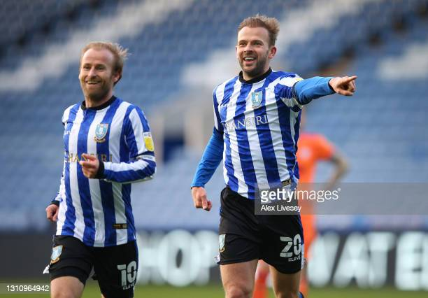 Jordan Rhodes of Sheffield Wednesday celebrates with team mate Barry Bannan after scoring their side's fourth goal during the Sky Bet Championship...