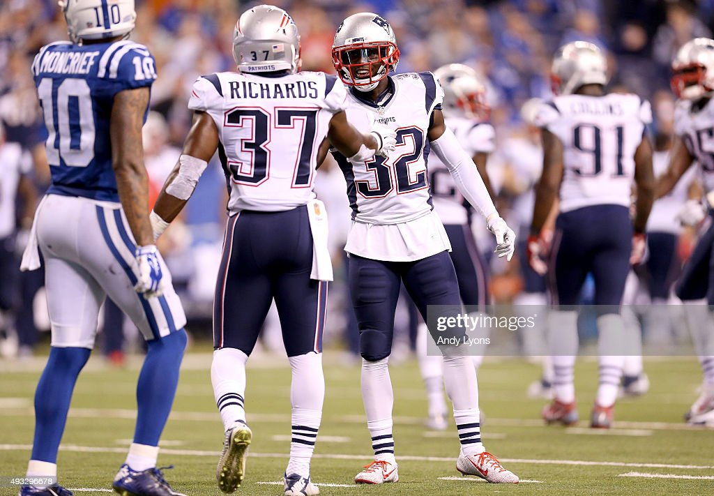 Jordan Richards #37 and Devin McCourtry #32 of the New England Patriots celebrate after a fourth down defensive stop in the fourth quarter against the Indianapolis Colts at Lucas Oil Stadium on October 18, 2015 in Indianapolis, Indiana.