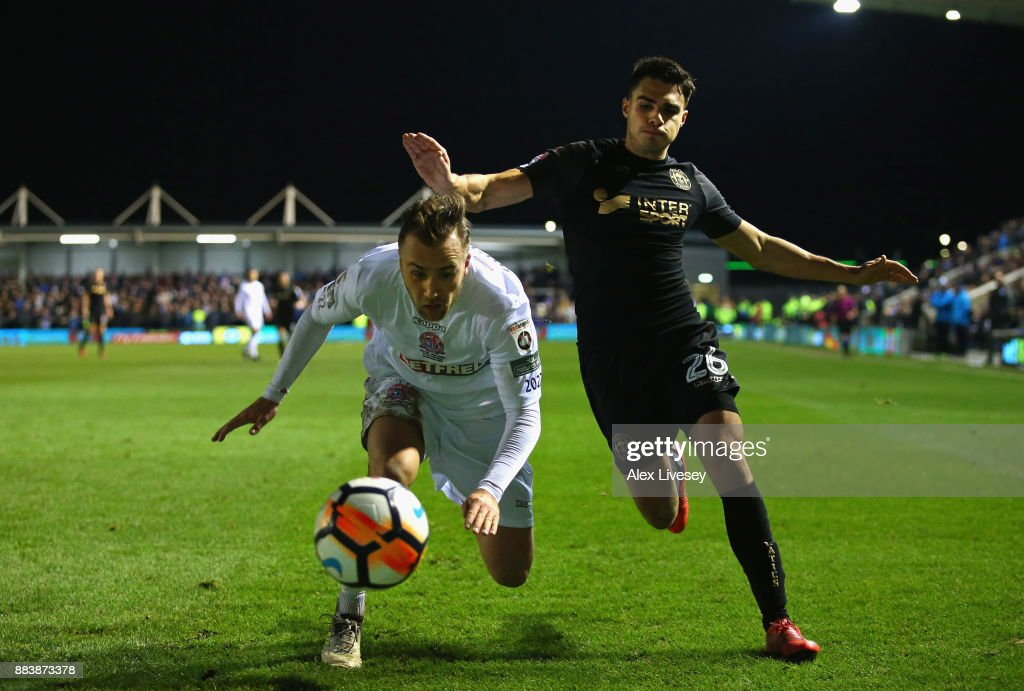 Jordan Richards of AFC Fylde and Reece James of Wigan Athletic compete for the ball during The Emirates FA Cup Second Round between AFC Fylde and Wigan Athletic on December 1, 2017 in Kirkham, England.