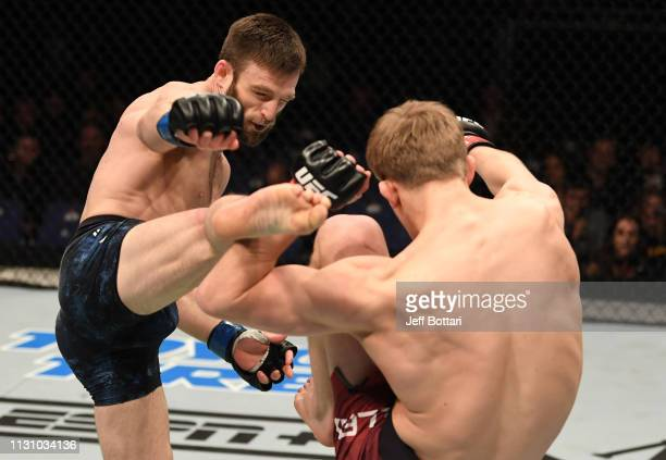 Jordan Rinaldi kicks Arnold Allen of England in their featherweight bout during the UFC Fight Night event at The O2 Arena on March 16 2019 in London...