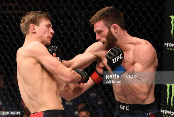 Jordan Rinaldi punches Arnold Allen of England in their featherweight bout during the UFC Fight Night event at The O2 Arena on March 16 2019 in...