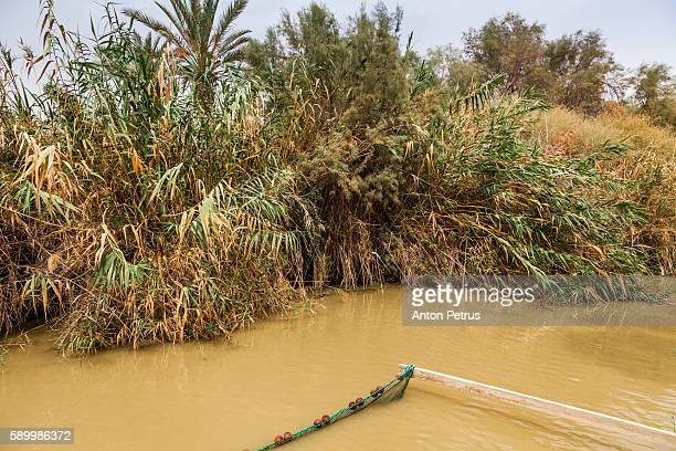 jordan river baptismal site - religious celebration stock pictures, royalty-free photos & images