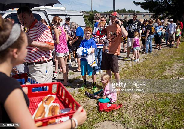 Jordan Roberts of Biddeford sells hotdogs to hockey fans waiting in line to see the 2016 Stanley Cup Brian Dumoulin a defensemen for the 2016 Stanley...