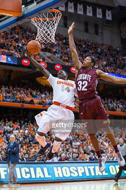 Jordan Robertson of the Colgate Raiders blocks a breakaway layup by Kaleb Joseph of the Syracuse Orange during the second half on December 22 2014 at...