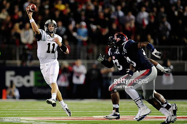 Jordan Rodgers of the Vanderbilt Commodores is pursued by defenders of the Ole Miss Rebels during a game at VaughtHemingway Stadium on November 10...
