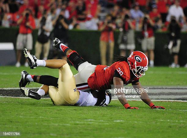 Jordan Rodgers of the Vanderbilt Commodores is sacked on a 4th down play by Jarvis Jones of the Georgia Bulldogs at Sanford Stadium on September 22...