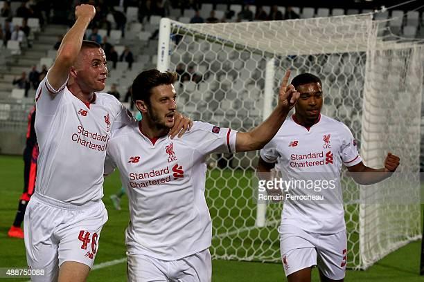 Jordan Rossiter Adam Lallana and Jordan Ibe after the goal of Adam Lallana for Liverpool FC during the Europa League game between FC Girondins de...